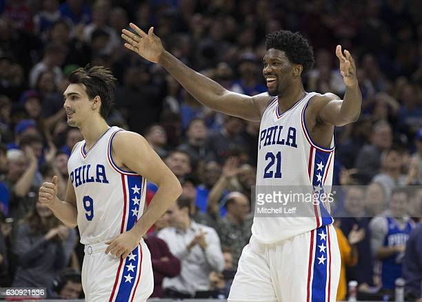 Joel Embiid and Dario Saric of the Philadelphia 76ers celebrate in the final moments of the game against the Minnesota Timberwolves at the Wells...