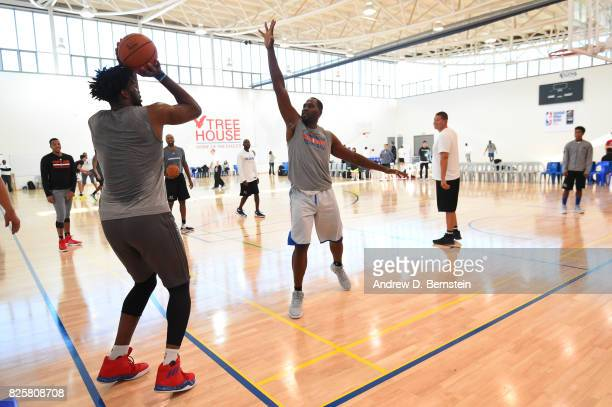 Joel Embiid and legend Elton Brand of the Philadelphia 76ers goes through a workout as part of Basketball Without Borders Africa at the American...