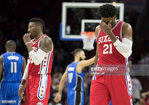 Joel Embiid and Robert Covington of the Philadelphia 76ers react in the final moments of the game against the Orlando Magic at Wells Fargo Center on...