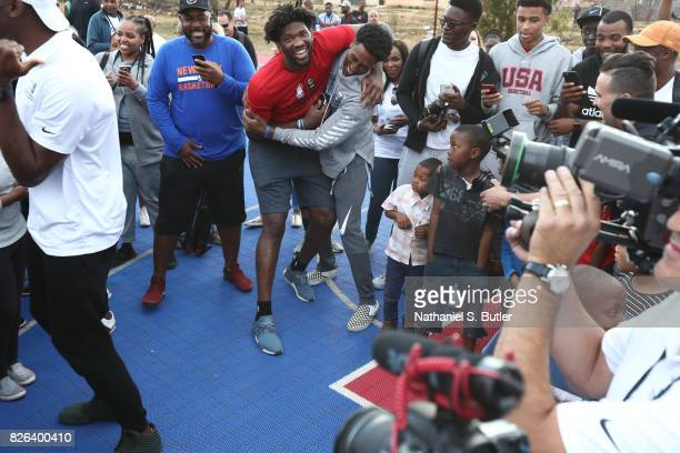 Joel Embiid and Rondae HollisJefferson of Team Africa interacts with the children as part of the Basketball Without Borders Africa at the SOS...