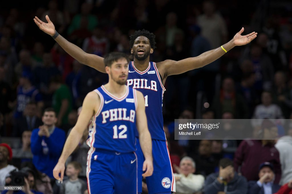 Joel Embiid #21 and T.J. McConnell #12 of the Philadelphia 76ers react in the fourth quarter against the Toronto Raptors at the Wells Fargo Center on January 15, 2018 in Philadelphia, Pennsylvania. The 76ers defeated the Raptors 117-111.