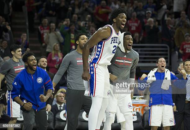 Joel Embiid Chasson Randle Jahlil Okafor Robert Covington and TJ McConnell of the Philadelphia 76ers celebrate from the bench against the Toronto...