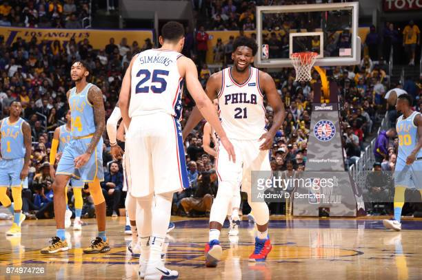 Joel Embiid high fives Ben Simmons of the Philadelphia 76ers during the game against the Los Angeles Lakers on November 15 2017 at STAPLES Center in...