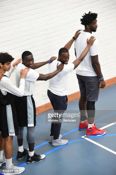 Joel Embiid of Team Africa and Kemba Walker of Team World goes through a leadership clinic during the Basketball Without Borders Africa at the...