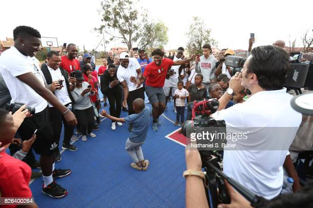 Joel Embiid of Team Africa interacts with the children as part of the Basketball Without Borders Africa at the SOS Children's Village on August 4...