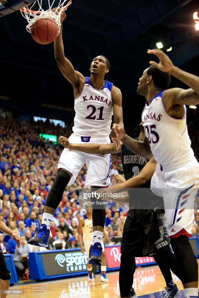 Joel Embiid of the Kansas Jayhawks dunks during the game against the Georgetown Hoyas at Allen Fieldhouse on December 21 2013 in Lawrence Kansas