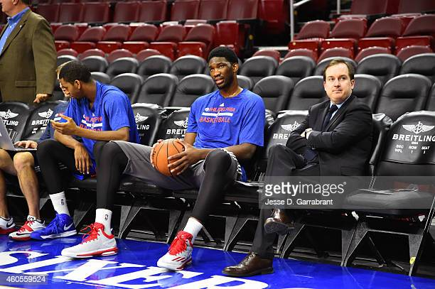 Joel Embiid of the Philadelphia 76er and Sam Hinkie General Manager of the Philadelphia 76ers before the game against the Boston Celtics on December...