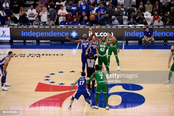Joel Embiid of the Philadelphia 76ers and Al Horford of the Boston Celtics jump for the tip off to start the game between the two teams on October 20...