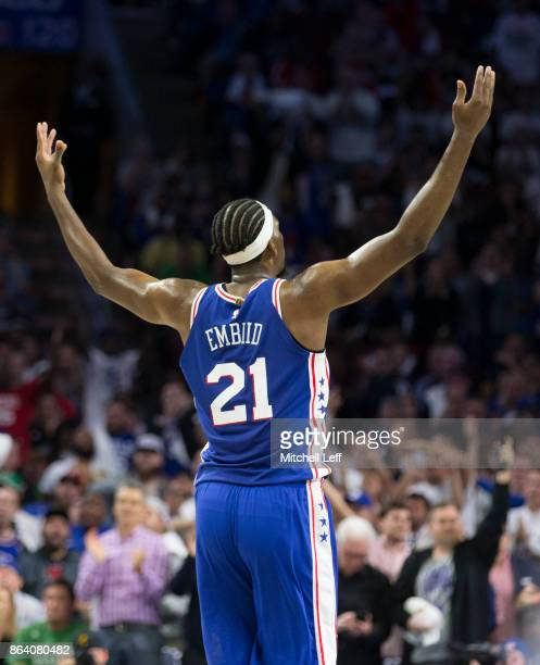 Joel Embiid of the Philadelphia 76ers asks the crowd to get loud in the second quarter against the Boston Celtics at the Wells Fargo Center on...