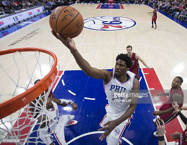 Joel Embiid of the Philadelphia 76ers attempts a layup against the Miami Heat at Wells Fargo Center on November 21 2016 in Philadelphia Pennsylvania...