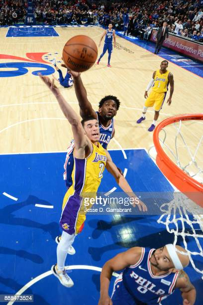 Joel Embiid of the Philadelphia 76ers blocks a shot against Lonzo Ball of the Los Angeles Lakers on December 7 2017 at Wells Fargo Center in...