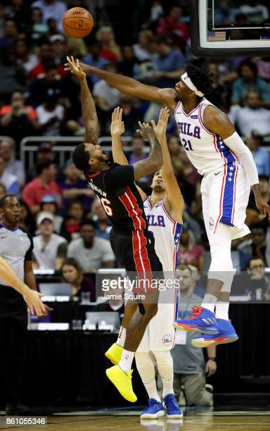 Joel Embiid of the Philadelphia 76ers blocks a shot by James Johnson of the Miami Heat during the 1st quarter of the game at Sprint Center on October...