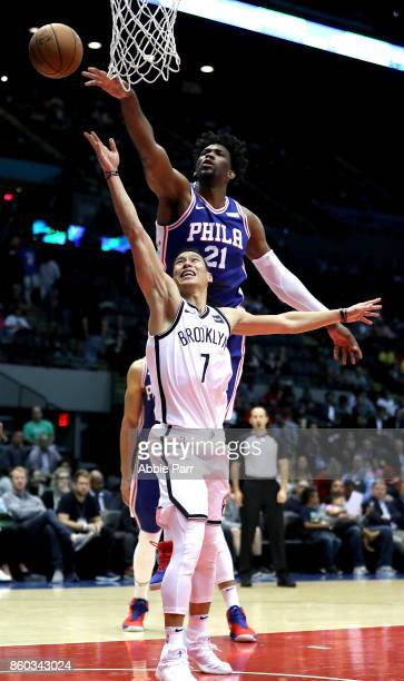Joel Embiid of the Philadelphia 76ers blocks a shot from Jeremy Lin of the Brooklyn Nets in the second half during their Pre Season game at Nassau...