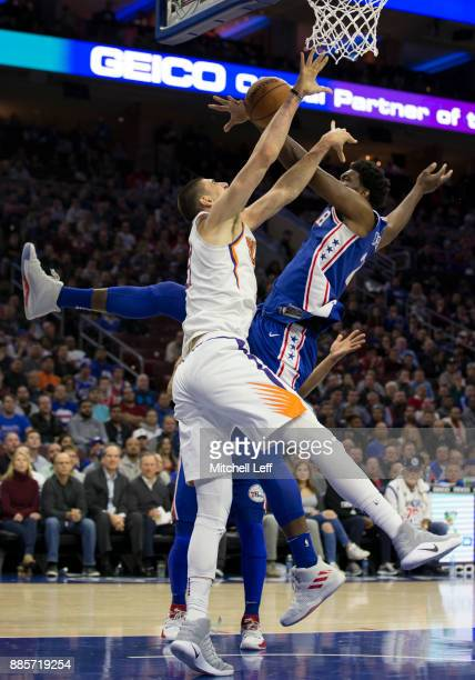 Joel Embiid of the Philadelphia 76ers blocks the shot of Alex Len of the Phoenix Suns in the first quarter at the Wells Fargo Center on December 4...