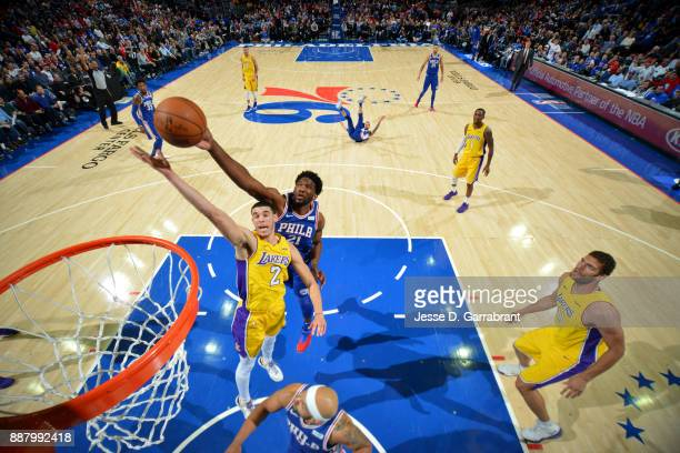 Joel Embiid of the Philadelphia 76ers blocks the shot on Lonzo Ball of the Los Angeles Lakers during the game between the two teams on December 7...