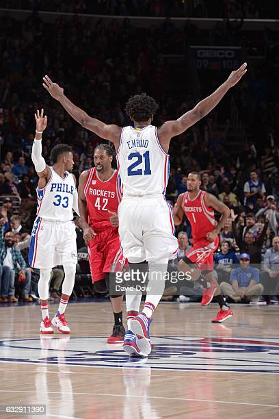 Joel Embiid of the Philadelphia 76ers celebrates a three point basket basket durig the game against the Houston Rockets at Wells Fargo Center on...