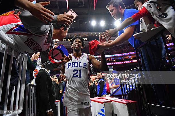 Joel Embiid of the Philadelphia 76ers celebrates with fans after defeating the New York Knicks on January 11 2017 in Philadelphia Pennsylvania NOTE...