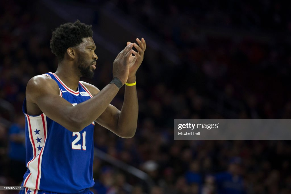 Joel Embiid #21 of the Philadelphia 76ers claps in the third quarter against the Toronto Raptors at the Wells Fargo Center on January 15, 2018 in Philadelphia, Pennsylvania. The 76ers defeated the Raptors 117-111.