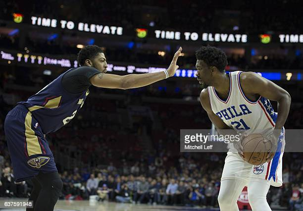 Joel Embiid of the Philadelphia 76ers controls the ball against Anthony Davis of the New Orleans Pelicans at Wells Fargo Center on December 20 2016...