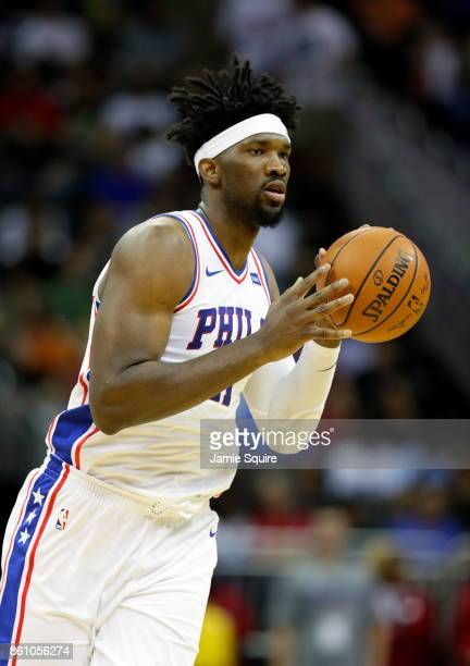 Joel Embiid of the Philadelphia 76ers controls the ball during the game against the Miami Heat at Sprint Center on October 13 2017 in Kansas City...