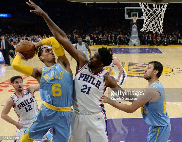 Joel Embiid of the Philadelphia 76ers defends against Jordan Clarkson of the Los Angeles Lakers during the second half of the basketball game at...