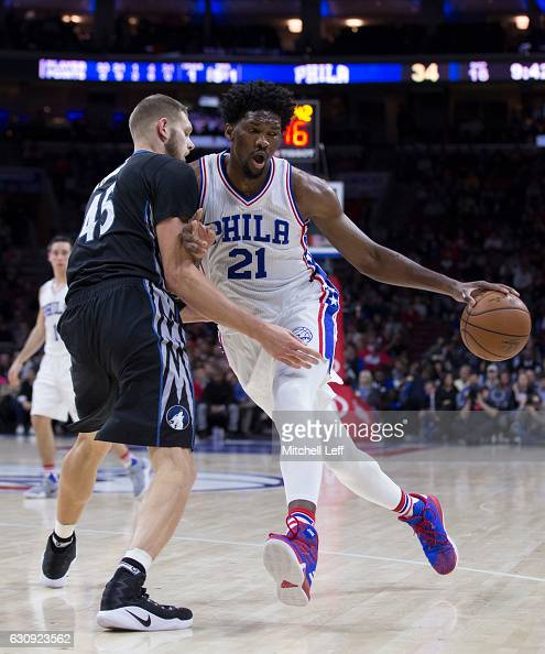 Joel Embiid of the Philadelphia 76ers dribbles the ball against Cole Aldrich of the Minnesota Timberwolves in the second quarter at the Wells Fargo...