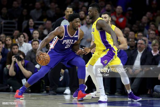 Joel Embiid of the Philadelphia 76ers drives to the basket against Julius Randle of the Los Angeles Lakers in the second half at Wells Fargo Center...