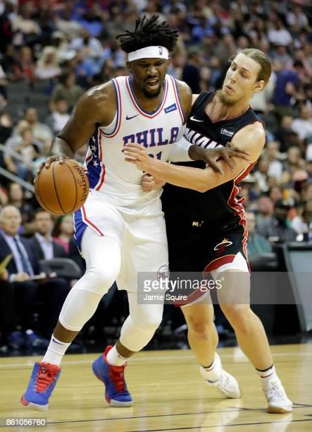 Joel Embiid of the Philadelphia 76ers drives toward the basket as Kelly Olynyk of the Miami Heat of the Miami Heat defends during the game at Sprint...