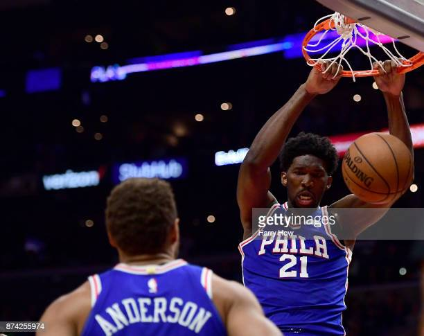 Joel Embiid of the Philadelphia 76ers dunks in front of Justin Anderson during a 109105 win over the LA Clippers at Staples Center on November 13...