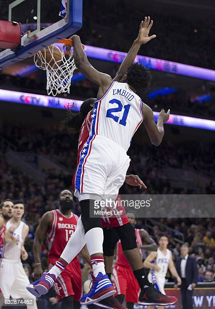 Joel Embiid of the Philadelphia 76ers dunks the ball against Nene Hilario of the Houston Rockets in the first quarter at the Wells Fargo Center on...
