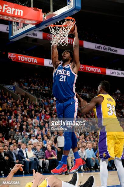 Joel Embiid of the Philadelphia 76ers dunks the ball during the game against the Los Angeles Lakers on December 7 2017 at Wells Fargo Center in...