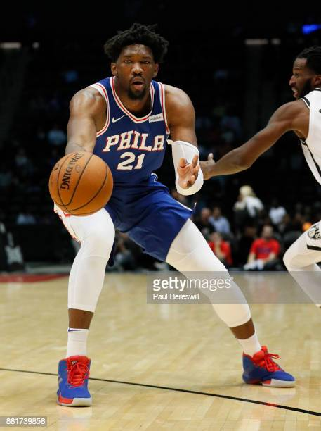 Joel Embiid of the Philadelphia 76ers gets a pass during a preseason NBA basketball game against the Brooklyn Nets on October 11 2017 at NYCB LIVE...