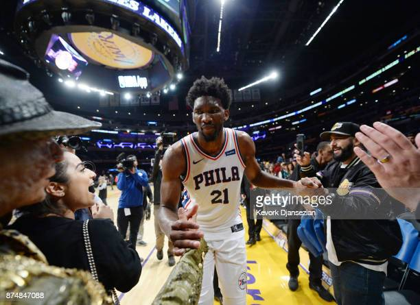 Joel Embiid of the Philadelphia 76ers gets congratulated by Los Angeles Lakers fans as leaves the basketball court scoring career high 46points...