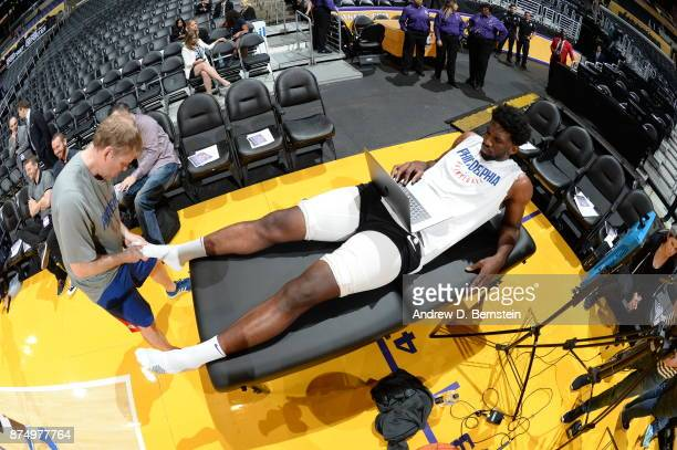 Joel Embiid of the Philadelphia 76ers gets taped before the game against the Los Angeles Lakers on November 15 2017 at STAPLES Center in Los Angeles...