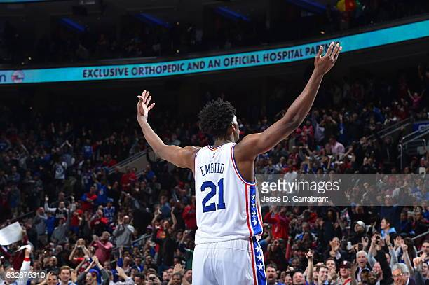 Joel Embiid of the Philadelphia 76ers gets the crowd pumped up against the Houston Rockets at Wells Fargo Center on January 27 2017 in Philadelphia...