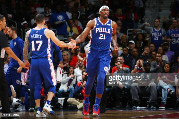 Joel Embiid of the Philadelphia 76ers gives a celebratory handshake to JJ Redick of the Philadelphia 76ers during the 201718 regular season game...