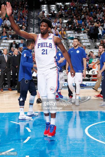 Joel Embiid of the Philadelphia 76ers gives high five to a teammate before the game against the Dallas Mavericks on October 28 2017 at the American...