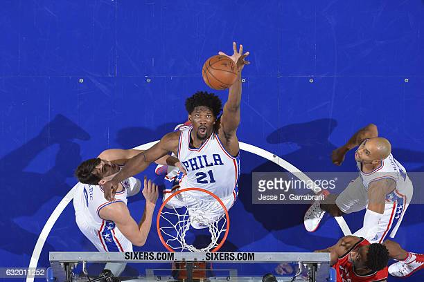 Joel Embiid of the Philadelphia 76ers goes for the rebound during the game against the Toronto Raptors on January 18 2017 at Wells Fargo Center in...