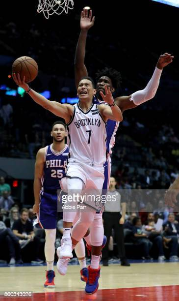 Joel Embiid of the Philadelphia 76ers goes to block a shot from Jeremy Lin of the Brooklyn Nets in the second half during their Pre Season game at...