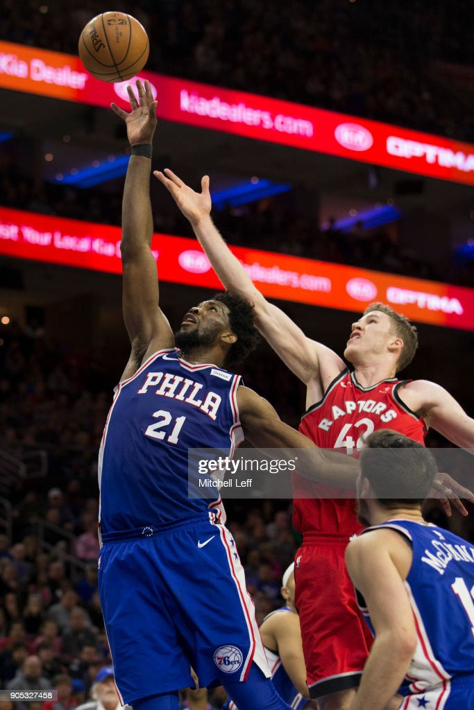 Joel Embiid #21 of the Philadelphia 76ers grabs a rebound against Jakob Poeltl #42 of the Toronto Raptors in the fourth quarter at the Wells Fargo Center on January 15, 2018 in Philadelphia, Pennsylvania. The 76ers defeated the Raptors 117-111.