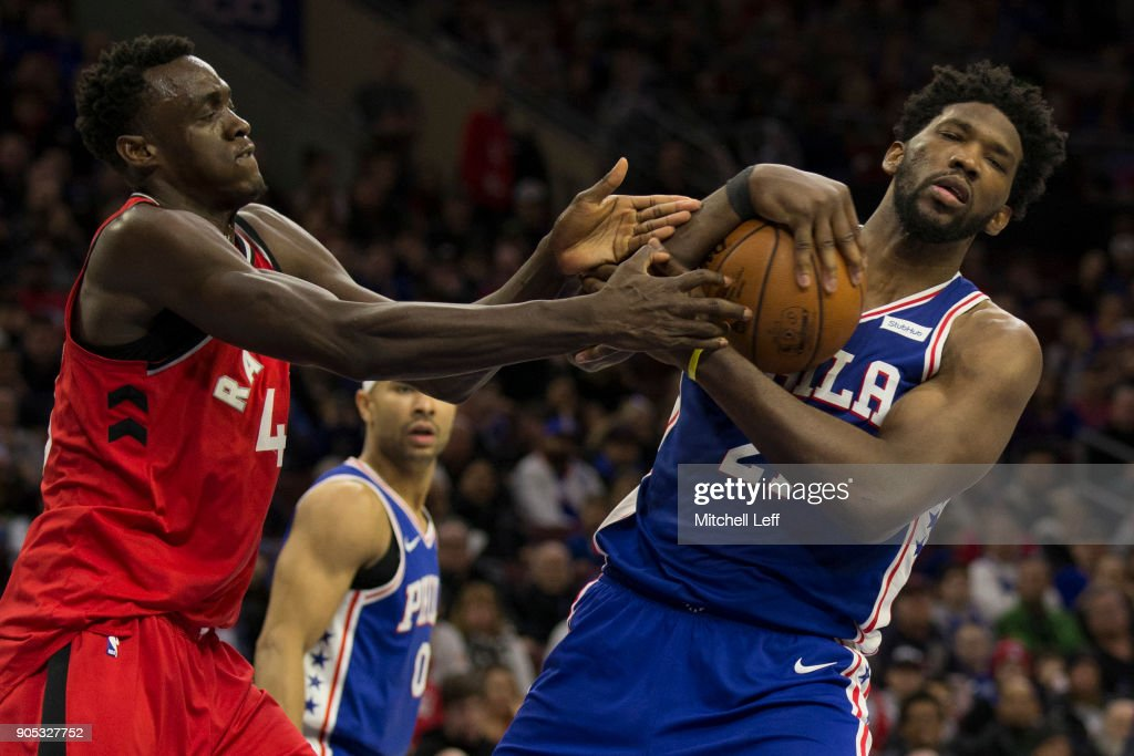 Joel Embiid #21 of the Philadelphia 76ers grabs a rebound and is fouled by Pascal Siakam #43 of the Toronto Raptors in the third quarter at the Wells Fargo Center on January 15, 2018 in Philadelphia, Pennsylvania. The 76ers defeated the Raptors 117-111.