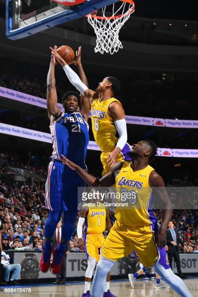Joel Embiid of the Philadelphia 76ers grabs the rebound against Jordan Clarkson of the Los Angeles Lakers on December 7 2017 at Wells Fargo Center in...