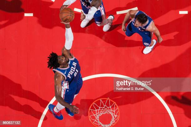 Joel Embiid of the Philadelphia 76ers grabs the rebound against the Brooklyn Nets during the preseason game on October 11 2017 at Nassau Veterans...