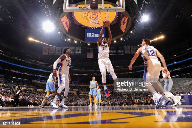 Joel Embiid of the Philadelphia 76ers grabs the rebound against the Los Angeles Lakers on November 15 2017 at STAPLES Center in Los Angeles...