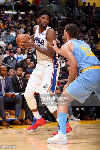 Joel Embiid of the Philadelphia 76ers handles the ball against the Los Angeles Lakers on November 15 2017 at STAPLES Center in Los Angeles California...