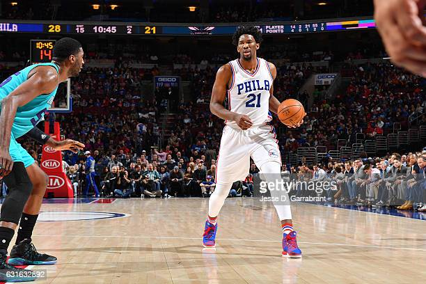Joel Embiid of the Philadelphia 76ers handles the ball during the game against the Charlotte Hornets on January 13 2017 at Wells Fargo Center in...