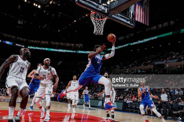 Joel Embiid of the Philadelphia 76ers handles the ball during the preseason game against the Brooklyn Nets on October 11 2017 at Nassau Veterans...