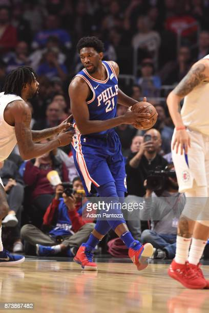 Joel Embiid of the Philadelphia 76ers handles the ball during the game against the LA Clippers on November 13 2017 at STAPLES Center in Los Angeles...