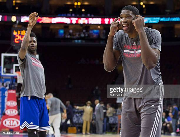 Joel Embiid of the Philadelphia 76ers has fun with Nerlens Noel during warm ups prior to the game against the Cleveland Cavaliers on January 10 2016...