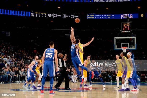 Joel Embiid of the Philadelphia 76ers jumps for the tip off to start the game against the Los Angeles Lakers on December 7 2017 at Wells Fargo Center...